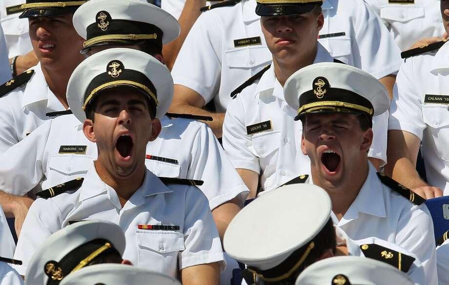 U.S. Naval Academy undergraduates yawn during graduation ceremonies. Photo: Mark Wilson, Getty Images