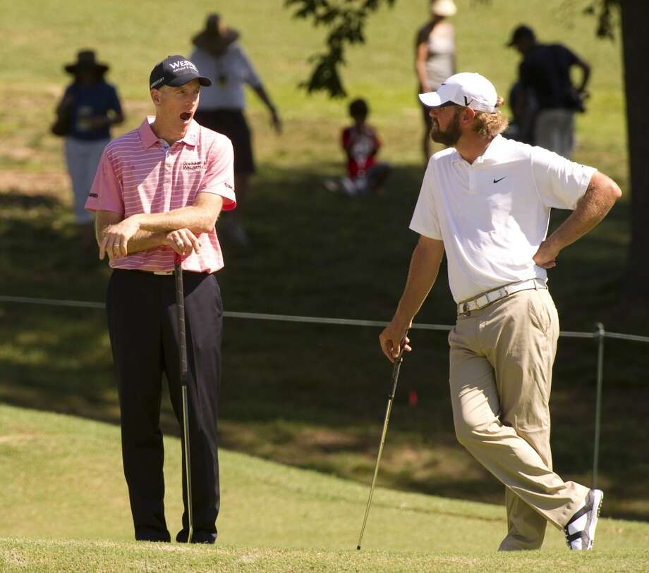Golfer Jim Furyk, left, with Lucas Glover, proving golf really is boring. Photo: DON EMMERT, AFP/Getty Images