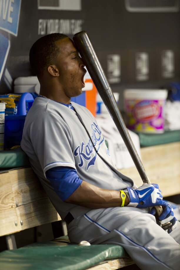 Alcides Escobar of the Kansas City Royals while hiding behind his baseball bat. Photo: Jason Miller, Getty Images