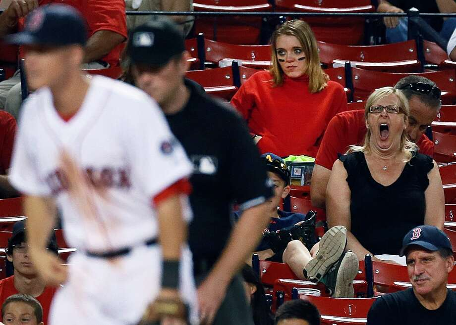 A fan has never been this bored at a Boston Red Sox game before. Photo: Boston Globe, Boston Globe Via Getty Images