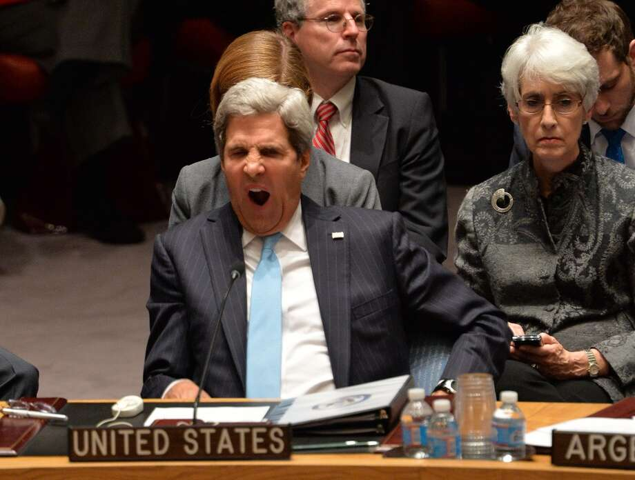 Secretary of State John Kerry shows that closing your eyes makes yawns work better. Photo: STAN HONDA, AFP/Getty Images