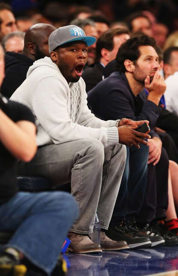 Rapper 50 Cent sees us seeing him yawn at a basketball game. Photo: Al Bello, Getty Images