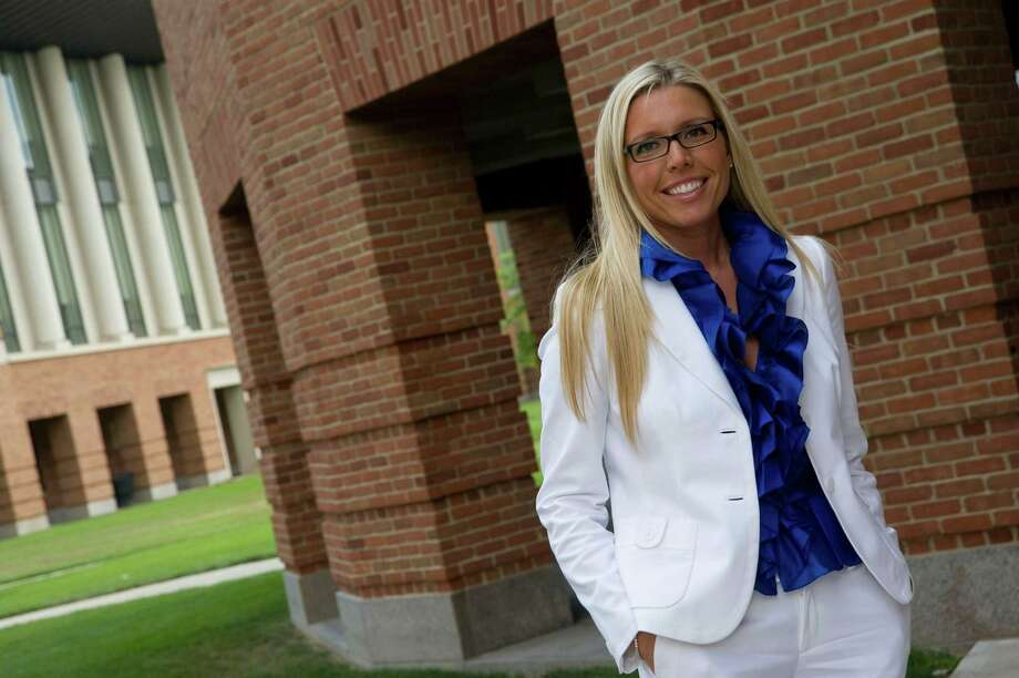 Among early adopters of the new rental economy is Southport resident Kathryn Queen, a vice president at Bodnar Capital Management. Queen rents handbags that sheâÄôll need just once, saving her most of the retail value of the item, in addition to closet space. Photo: Contributed Photo, Jo McCulty/ Ohio State Universit / Connecticut Post Contributed