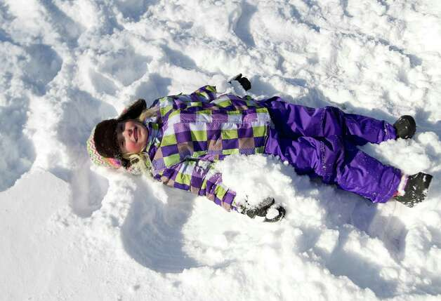Marisa Olander, 5, plays in the snow at Daskam Park in Stamford, Conn., on Friday, January 3, 2014. Photo: Lindsay Perry / Stamford Advocate