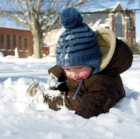 Roland Olander, 1, plays in the snow at Daskam Park in Stamford, Conn., on Friday, January 3, 2014. Photo: Lindsay Perry / Stamford Advocate