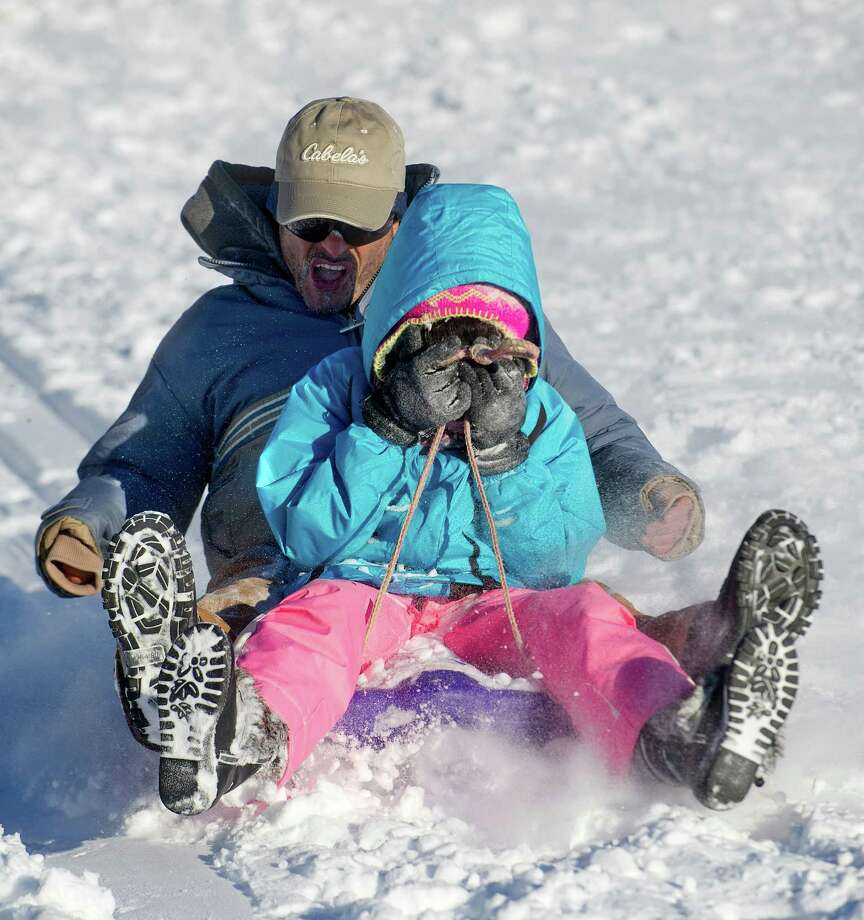 Sledders take to the hills at Cummings Beach Park in Stamford, Conn., on Friday, January 3, 2014. Photo: Lindsay Perry / Stamford Advocate
