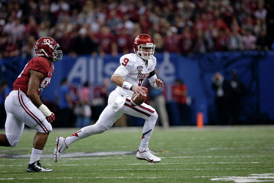 Oklahoma quarterback Trevor Knight (9) scrambles in the first half of the NCAA college football Sugar Bowl against Alabama in New Orleans, Thursday, Jan. 2, 2014. Photo: Patrick Semansky, Associated Press / AP