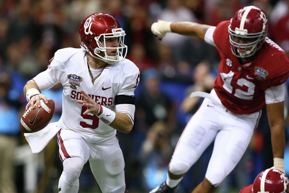 Trevor Knight #9 of the Oklahoma Sooners looks to throw a pass against the Alabama Crimson Tide during the Allstate Sugar Bowl at the Mercedes-Benz Superdome on January 2, 2014 in New Orleans. Photo: Streeter Lecka, Getty Images / 2014 Getty Images