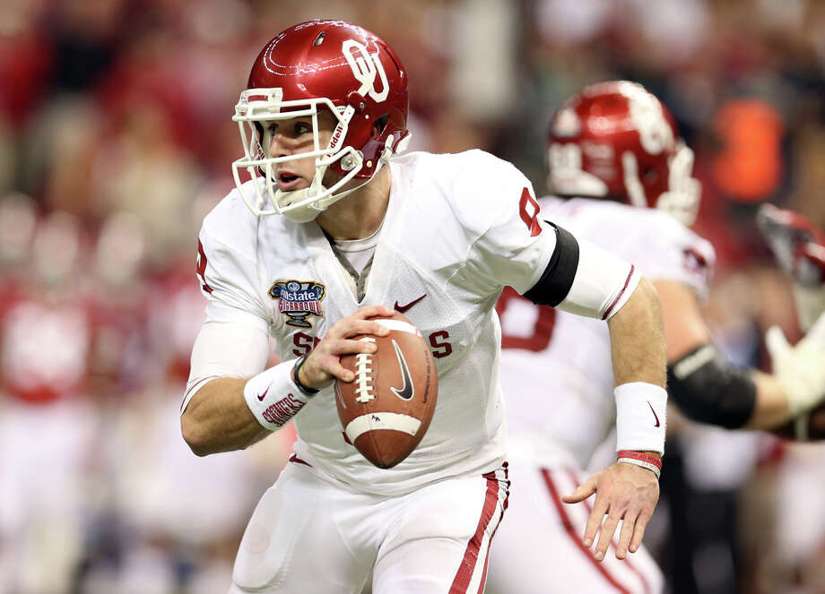 Trevor Knight #9 of the Oklahoma Sooners looks to pass against the Alabama Crimson Tide during the Allstate Sugar Bowl at the Mercedes-Benz Superdome on January 2, 2014 in New Orleans. Photo: Sean Gardner, Getty Images / 2014 Getty Images