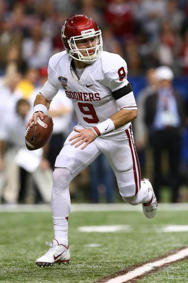 Trevor Knight #9 of the Oklahoma Sooners looks to throw a pass against the Alabama Crimson Tide during the Allstate Sugar Bowl at the Mercedes-Benz Superdome on January 2, 2014 in New Orleans. Photo: Streeter Lecka, Getty Images