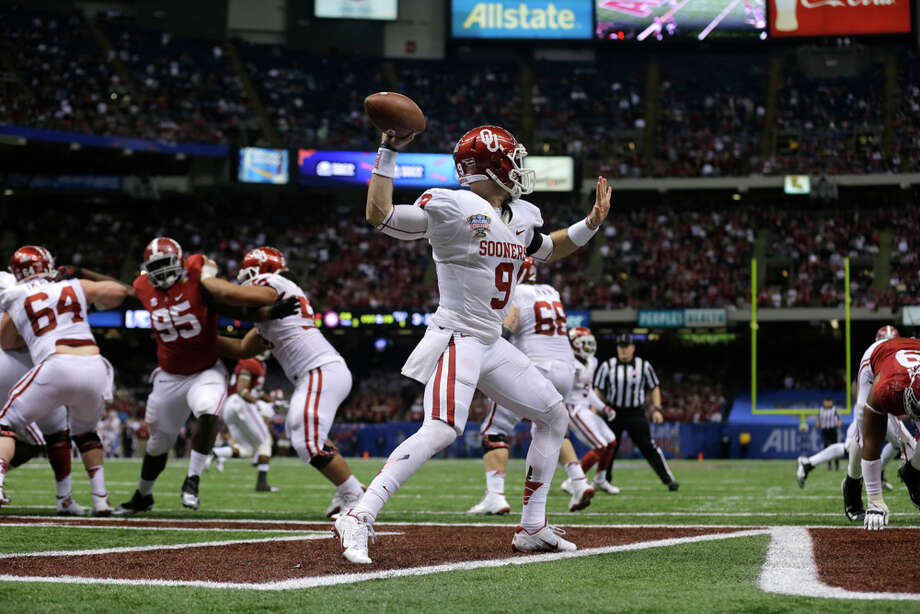 Oklahoma quarterback Trevor Knight (9) passes from his own end zone after the NCAA college football Sugar Bowl against Alabama in New Orleans, Thursday, Jan. 2, 2014.  Oklahoma won 45-31. Photo: Patrick Semansky, Associated Press / AP