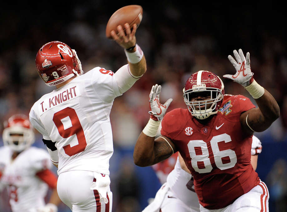 Trevor Knight #9 of the Oklahoma Sooners is pressured by A'Shawn Robinson #86 of the Alabama Crimson Tide during the Allstate Sugar Bowl at the Mercedes-Benz Superdome on January 2, 2014 in New Orleans. Photo: Stacy Revere, Getty Images / 2014 Getty Images