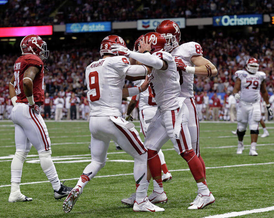 Oklahoma wide receiver Sterling Shepard (3) celebrates his touchdown reception with quarterback Trevor Knight (9) in the second half of the NCAA college football Sugar Bowl in New Orleans, Thursday, Jan. 2, 2014. Photo: Rusty Costanza, Associated Press / FR170655 AP