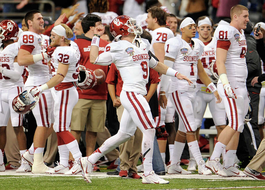 Trevor Knight #9 of the Oklahoma Sooners celebrates after defeating the Alabama Crimson Tide 45-31 in the Allstate Sugar Bowl at the Mercedes-Benz Superdome on January 2, 2014 in New Orleans. Photo: Stacy Revere, Getty Images / 2014 Getty Images