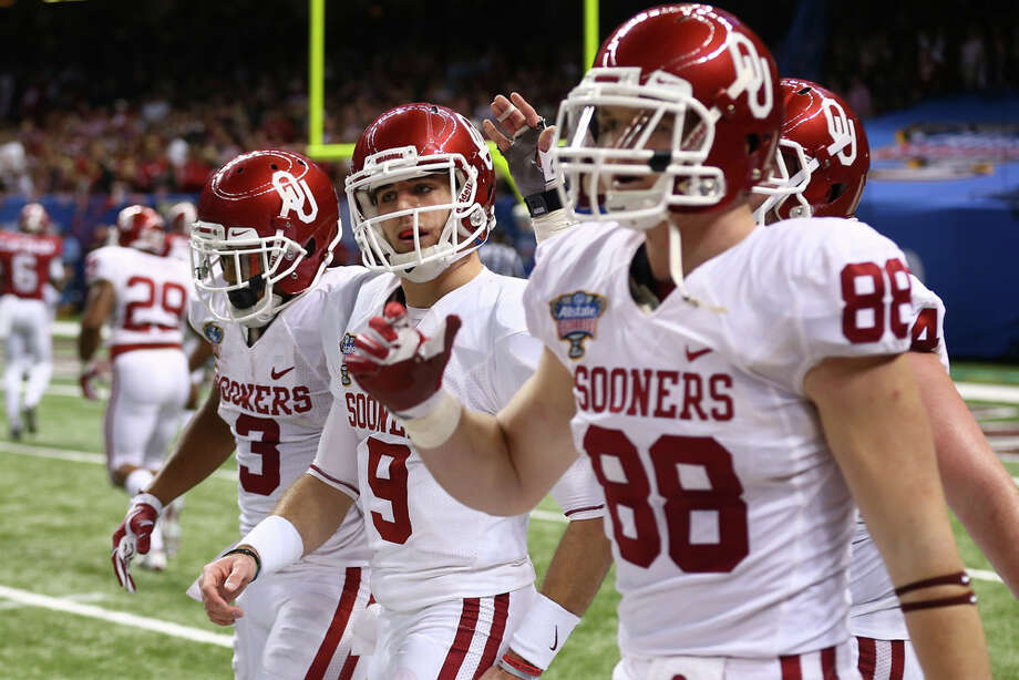 Trevor Knight #9 of the Oklahoma Sooners reacts after scoring a touchdown against the Alabama Crimson Tide during the Allstate Sugar Bowl at the Mercedes-Benz Superdome on January 2, 2014 in New Orleans. Photo: Streeter Lecka, Getty Images / 2014 Getty Images