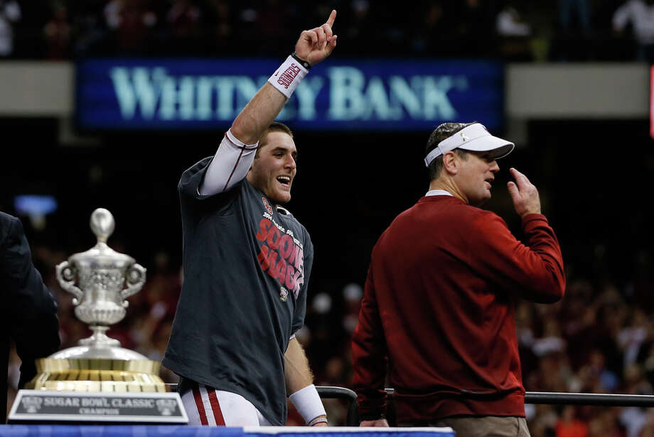 Head coach Bob Stoops and MVP Trevor Knight #9 of the Oklahoma Sooners celebrate after their 45-31 win over the Alabama Crimson Tide during the Allstate Sugar Bowl at the Mercedes-Benz Superdome on January 2, 2014 in New Orleans. Photo: Kevin C. Cox, Getty Images / 2014 Getty Images