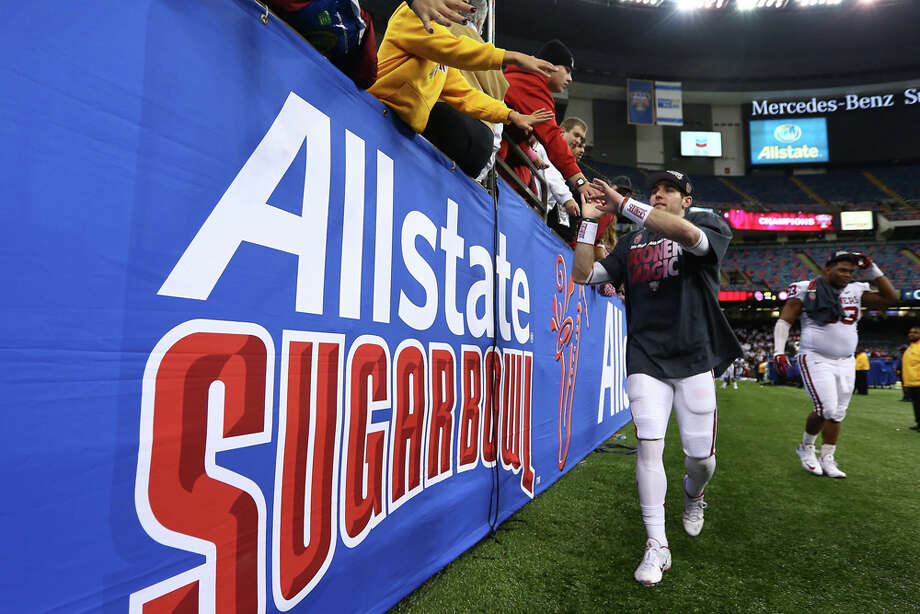 Trevor Knight #9 of the Oklahoma Sooners celebrates with the MVP trophy after defeating the Alabama Crimson Tide 45-31 during the Allstate Sugar Bowl at the Mercedes-Benz Superdome on January 2, 2014 in New Orleans. Photo: Streeter Lecka, Getty Images / 2014 Getty Images