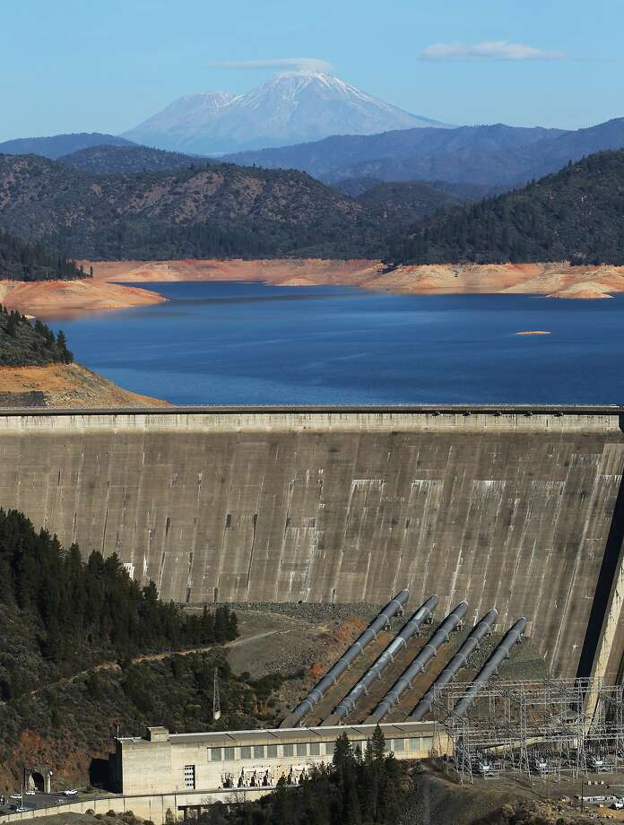 Call it the dry Shastas. The drought has left Mt. Shasta without its usual mantle of winter snow and Lake Shasta at low levels as shown in this photograph taken near Shasta Dam in Shasta County, Calif., on Tuesday, Dec. 31, 2013. Photo: Andreas Fuhrmann, Associated Press