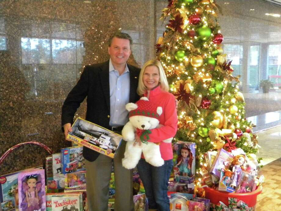 CB&I employees donated hundreds of toys for the Interfaith of The Woodlands' holiday giving program. Patrick Mullen, left, executive vice president of CB&I, and Ann Snyder, president and CEO of Interfaith, stand near some of the offerings. Photo: Courtesy Of Interfaith Of The Woodlands