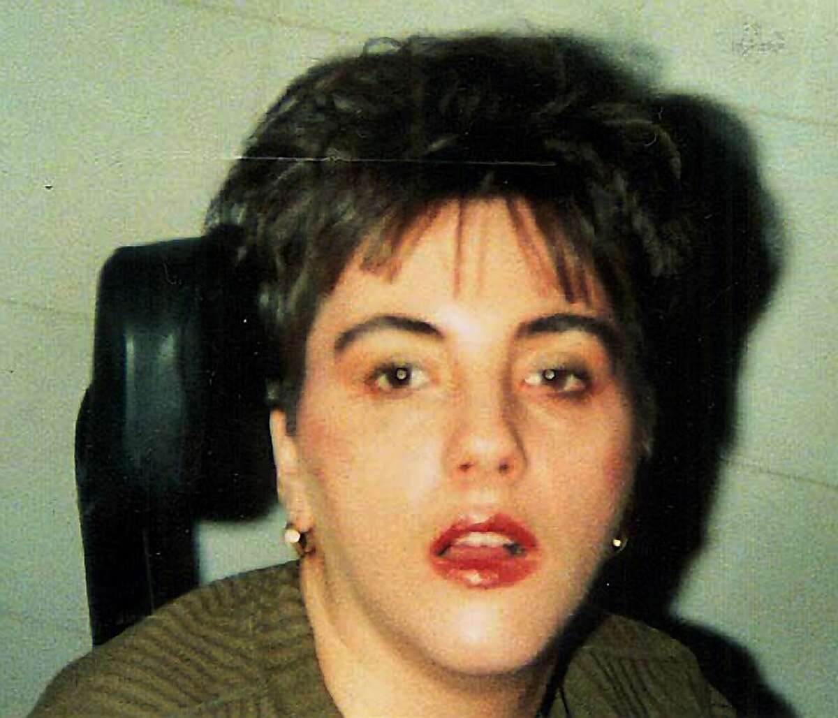 **FILE** Terri Schiavo is shown in this undated Schindler family photo taken shortly after she had a heart attack in 1990. The medical examiner's office plans to release its autopsy report Wednesday on Terri Schiavo _ findings her family hopes will shed light on the cause of the collapse that left her severely brain-damaged 15 years ago. Schiavo, 41, died March 31, nearly two weeks after the feeding tube that had kept her alive was removed under a court order obtained by her husband, Michael Schiavo. (AP Photo/Schindler Family Photo, File) **NO SALES** Ran on: 06-16-2005 Dr. Jon Thogmartin (right) discusses the results of the autopsy performed on Terri Schiavo as Dr. Stephen Nelson looks on.