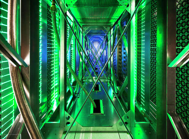 Computer servers like these at a Google data center in Mayes County, Okla., process lots of e-mails and other data from people. Photo: Connie Zhou, Associated Press