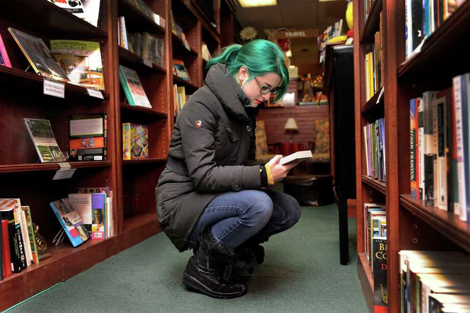 Tess Kaiser of New Milford, Conn., 18, browses for books at the Bank Street Book Nook in New Milford, Friday, Jan. 3, 2014. The book store will be closing soon. Photo: Carol Kaliff / The News-Times