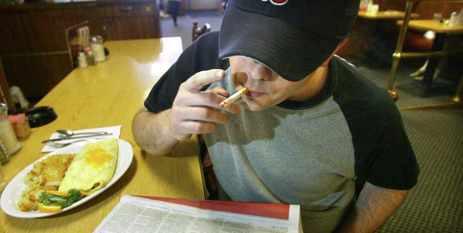 "A cigarette with eggs at the Ballard Smoke Shop in 2004. At the time, the bar and restaurant opposed a public-places smoking ban, with a waitress saying, ""It would kill us."" Photo: KAREN DUCEY, P-I File"