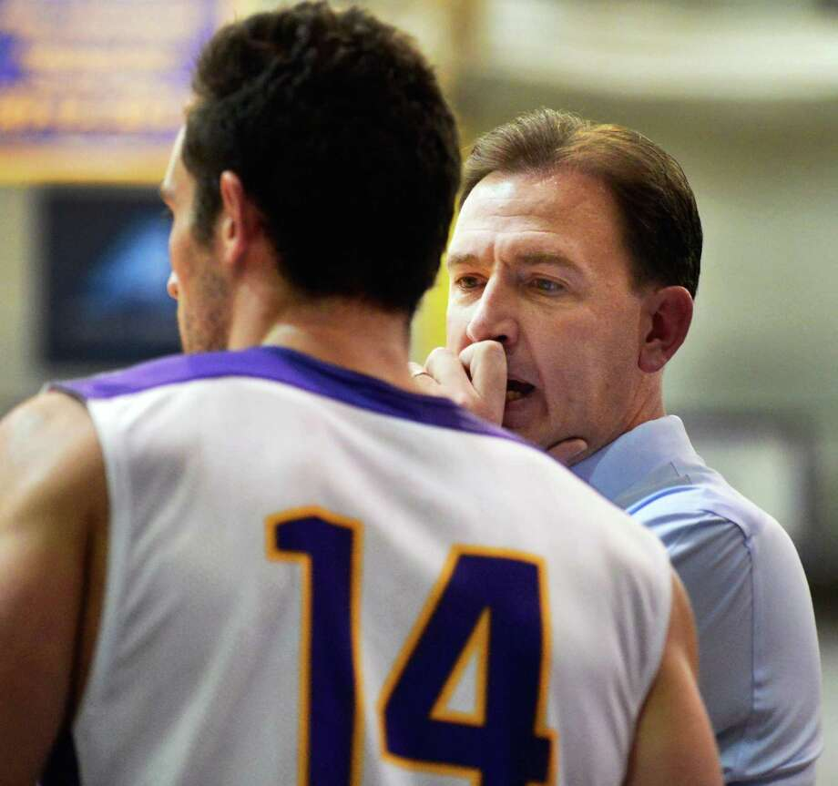 UAlbany's #14 Sam Rowley, left, gets some sidelines advice from head coach Will Brown during Saturday's game against Bucknell at the Sefcu Arena Nov. 23, 2013, in Abany, NY.  (John Carl D'Annibale / Times Union) Photo: John Carl D'Annibale / 00024711A