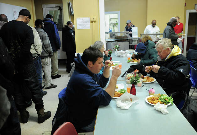 Bridgeport Rescue Mission guest eat dinner at the mission in Bridgeport, Conn. on Friday January 3, 2014. Photo: Christian Abraham / Connecticut Post