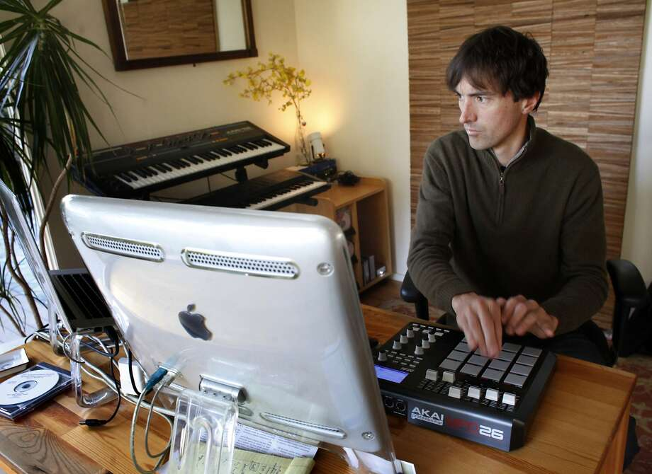 Mason Bates works on a composition in his Burlingame home in 2013. His Steve Jobs opera will have a workshop performance in September. Photo: Lacy Atkins, The Chronicle