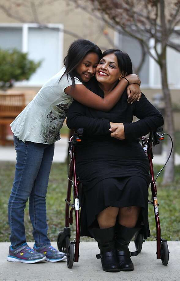 Mary Trejo, 50, right, pictured with her daughter Maryana Brooks, 10, at their new home in the Borregas Court Apartment complex December 26, 2013 in Sunnyvale, Calif. Trejo and her daughter became temporarily homeless after she was injured  on the job during core training at the Santa Clara County Juvenile Hall in 2011 and was then unable to work and thus unable to make her house payments. Trejo recently had a full knee replacement after re-injuring herself earlier this fall when she fell down a flight of stairs. Photo: Leah Millis, The Chronicle
