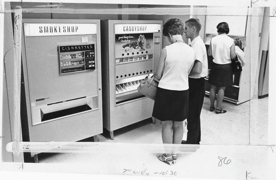 In 1969, Swedish Medical Center sold cigarettes (and candy) in its lobby vending machines.  Photo: Copyright MOHAI, Seattle Post-Intelliencer Collection,