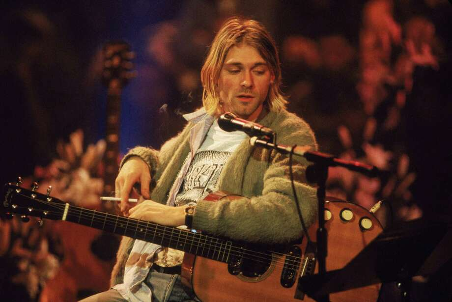 Sure, it's a ratty old sweater. But Kurt Cobain wore it on 'MTV Unplugged,' on Nov. 18, 1993. Photo: Frank Micelotta, Getty Images / 2004 Getty Images