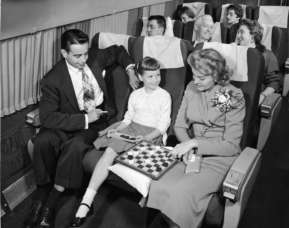 Breathing other people's cigarette fumes used to be a part of flying. But in 1973, airlines were required to maintain separate smoking and non-smoking sections, which helped. Smoking was banned on most domestic flights in 1990, and on international flights in 2000. Photo is from the 1950s.  Photo: Frederic Lewis, Getty Images / 2005 Getty Images