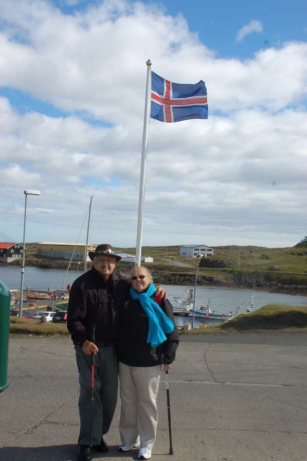 Tony and Jean Ramirez of San Francisco standing in front of the flag of Iceland. Photo: Courtesy Tony Ramirez
