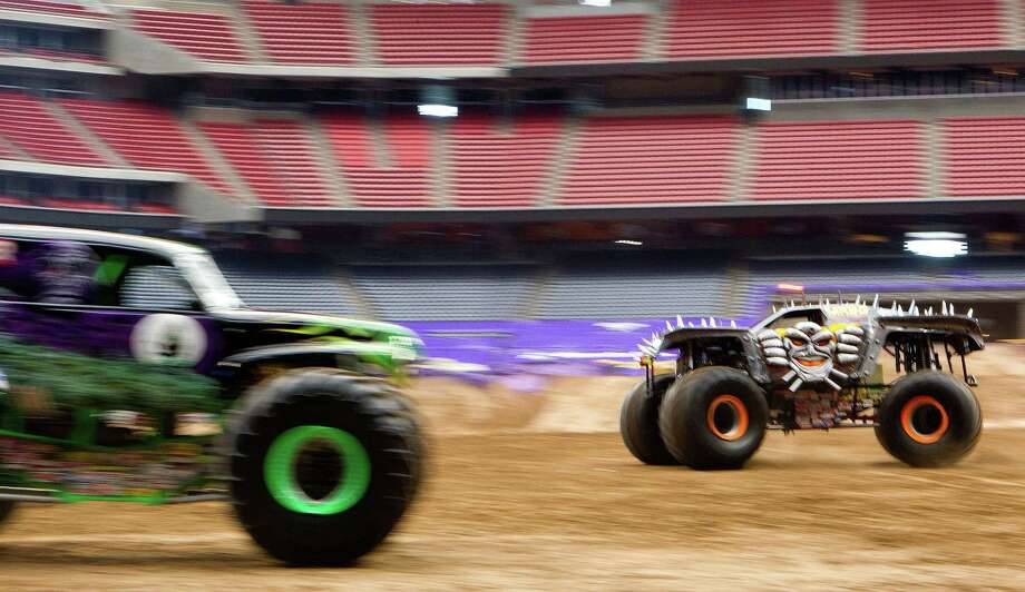Max-D driven by Tom Meents gives a demonstration for the media in Reliant Stadium Friday, Jan. 3, 2014, in Houston. The Monster Jam event Saturday features 24 monster trucks including Grave Digger, Scooby-Doo, Toro Loco, and Mohawk Warrior. The trucks will compete in a race and freestyle event. Photo: Johnny Hanson, Houston Chronicle / © 2014  Houston Chronicle