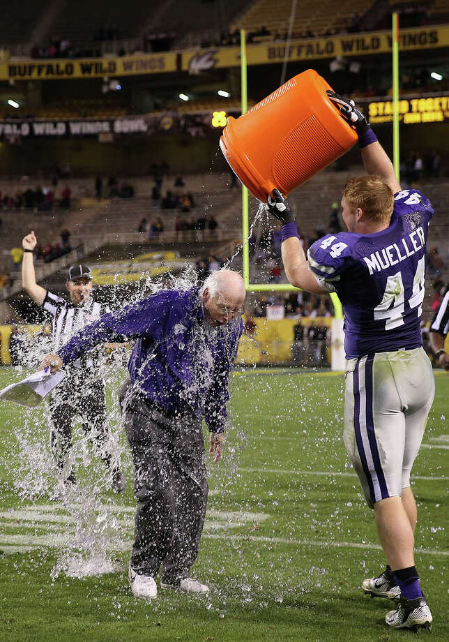 Kansas State defensive end Ryan Mueller (44) gets head coach Bill Snyder