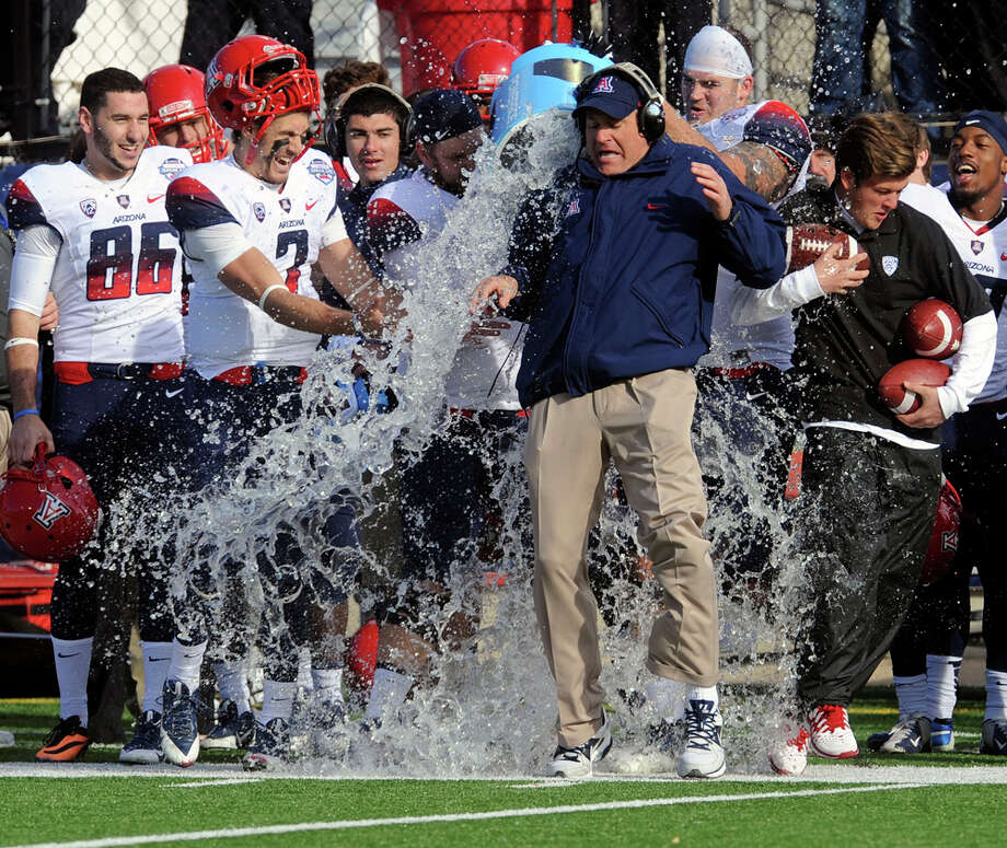 Arizona head coach Rich Rodriquez gets doused with water as the final seconds tick away in their 42-19 win over Boston College in the AdvoCare V100 Bowl on Jan 31, 2013, at Independence Stadium in Shreveport, La. Photo: Douglas Collier, Associated Press / The Shreveport Times