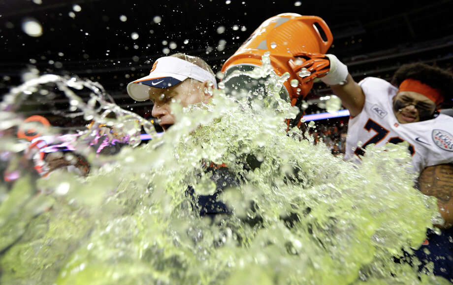 Syracuse coach Scott Shafer is doused after winning the Texas Bowl 