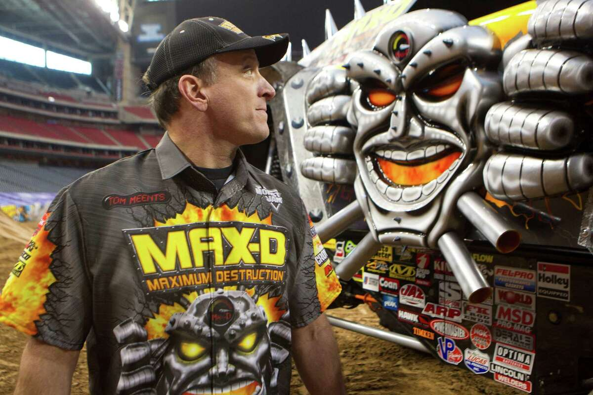 Max-D driver Tom Meents walks past his truck before giving a demonstration for the media in Reliant Stadium Friday, Jan. 3, 2014, in Houston. The Monster Jam event Saturday features 24 monster trucks including Grave Digger, Scooby-Doo, Toro Loco, and Mohawk Warrior. The trucks will compete in a race and freestyle event.