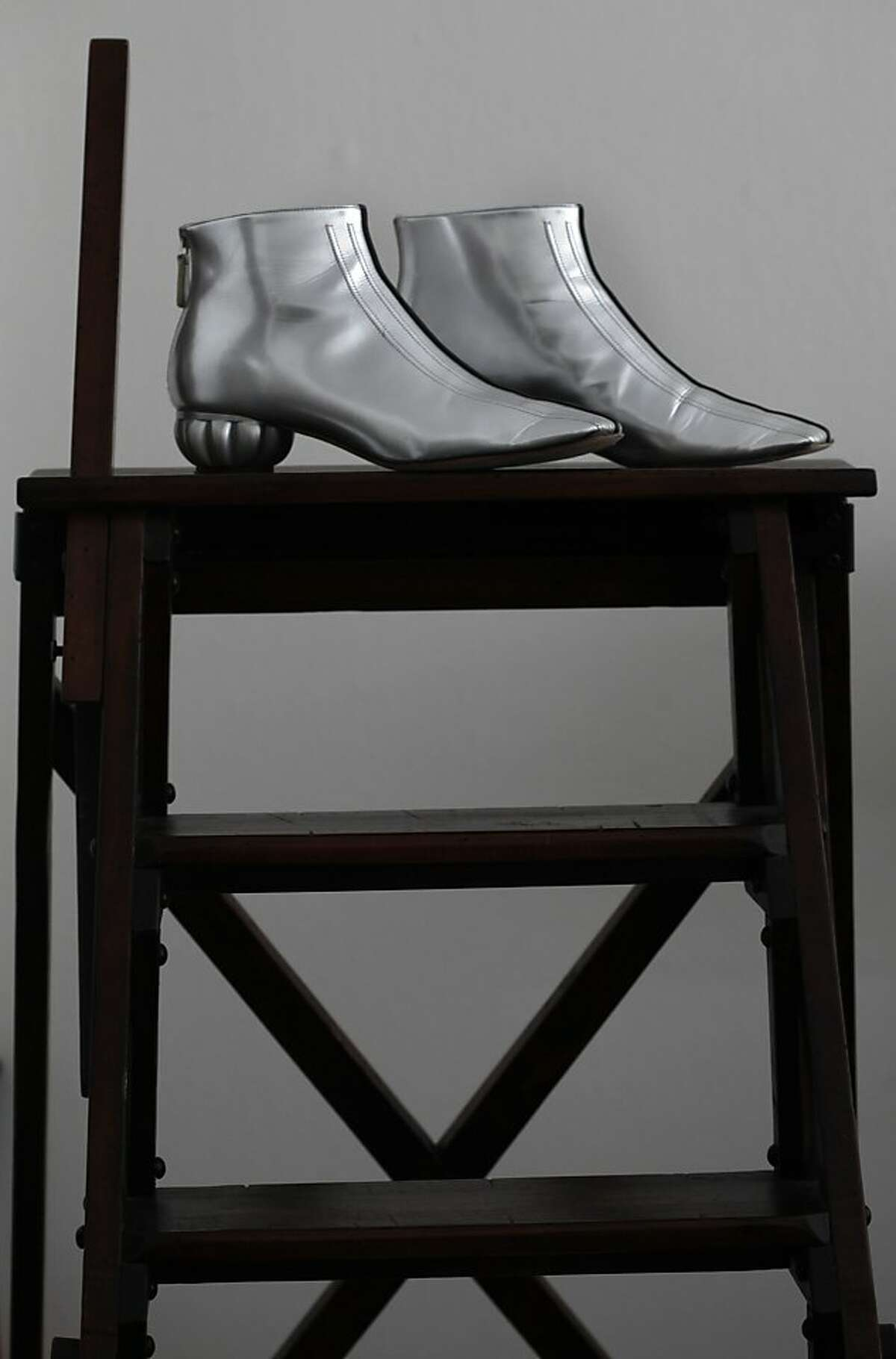 Tanya Powell, chairwoman of this year's San Francisco Ballet gala opening night shows her pair of silver Chanel boots at home in San Francisco, Calif., on Tuesday, December 31, 2013.