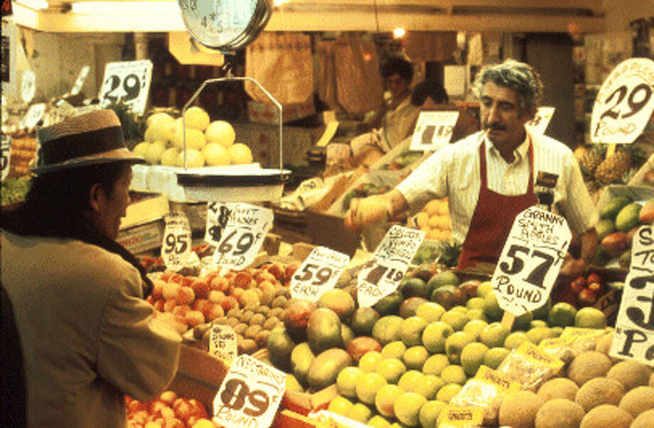 Pike Place Market, 1976: When smoking while working and selling fruit was totally normal. Photo: Seattle Municipal Archives