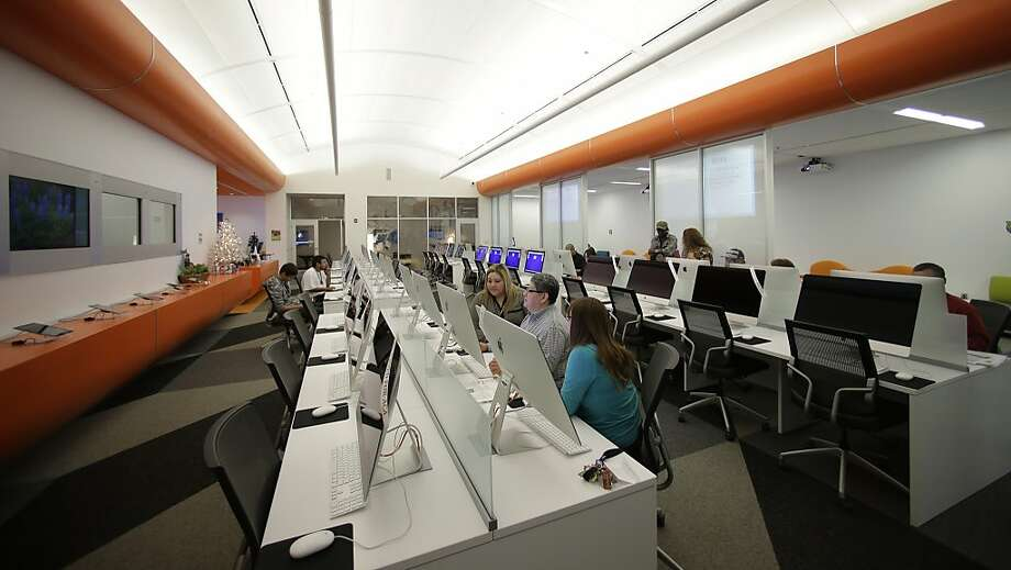 Patrons at BiblioTech in San Antonio use computers. The Bexar County public library is the first in the nation that does not have any books, but e-readers can be loaded up and checked out. Photo: Eric Gay, Associated Press