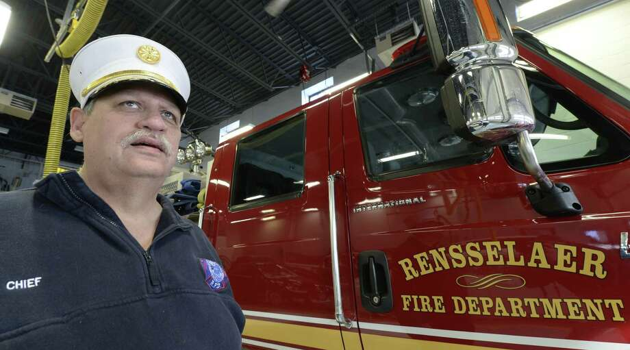 Phil Foust stands by a fire engine on his last day as Rensselaer Fire Department Chief of Department Friday Jan. 3, 2013 in Rensselaer, N.Y.   (Skip Dickstein / Times Union) Photo: Skip Dickstein / 00025231A