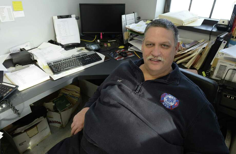 Phil Foust sits in his office on the last day of his job as Rensselaer Fire Department Chief of Department Friday Jan. 3, 2013 in Rensselaer, N.Y.   (Skip Dickstein / Times Union) Photo: Skip Dickstein / 00025231A