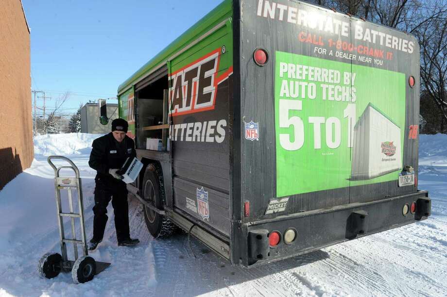 Andy Breen of Interstate Batteries makes a delivery to Firestone on Friday Jan. 3, 2014 in Colonie , N.Y. (Michael P. Farrell/Times Union) Photo: Michael P. Farrell