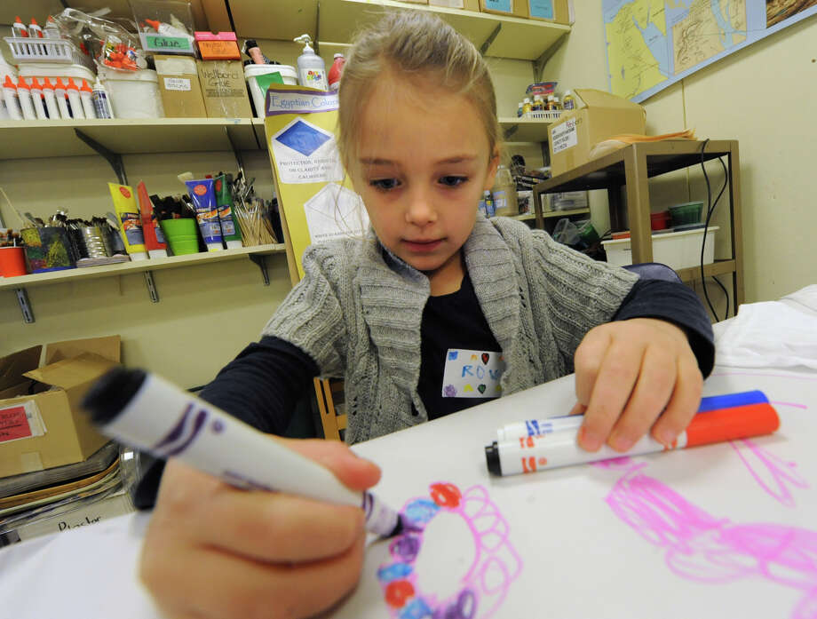Rowen Hoehn, 6, of Albany practices drawing before making t-shirts with Egyptian symbols or designs on them in the studio of the Albany Institute of History and Art on Friday, Jan. 3, 2014 in Albany, N.Y. (Lori Van Buren / Times Union) Photo: Lori Van Buren / 00025239A