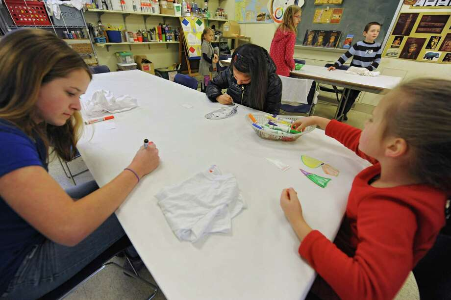 Children practice drawing before making t-shirts with Egyptian symbols or designs on them in the studio of the Albany Institute of History and Art on Friday, Jan. 3, 2014 in Albany, N.Y. Drawing on the foreground table from left are Gabriella Jourdin, 12, of Guilderland, Whitney Wilson, 13, of Averill Park and Lilliana Jourdin, 6, of Guilderland. At far table from left are Rowen Hoehn, 6, of Albany, Olivia Witkowski, 10, of Albany and Caeben Dady, 8, of Guilderland.  (Lori Van Buren / Times Union) Photo: Lori Van Buren / 00025239A