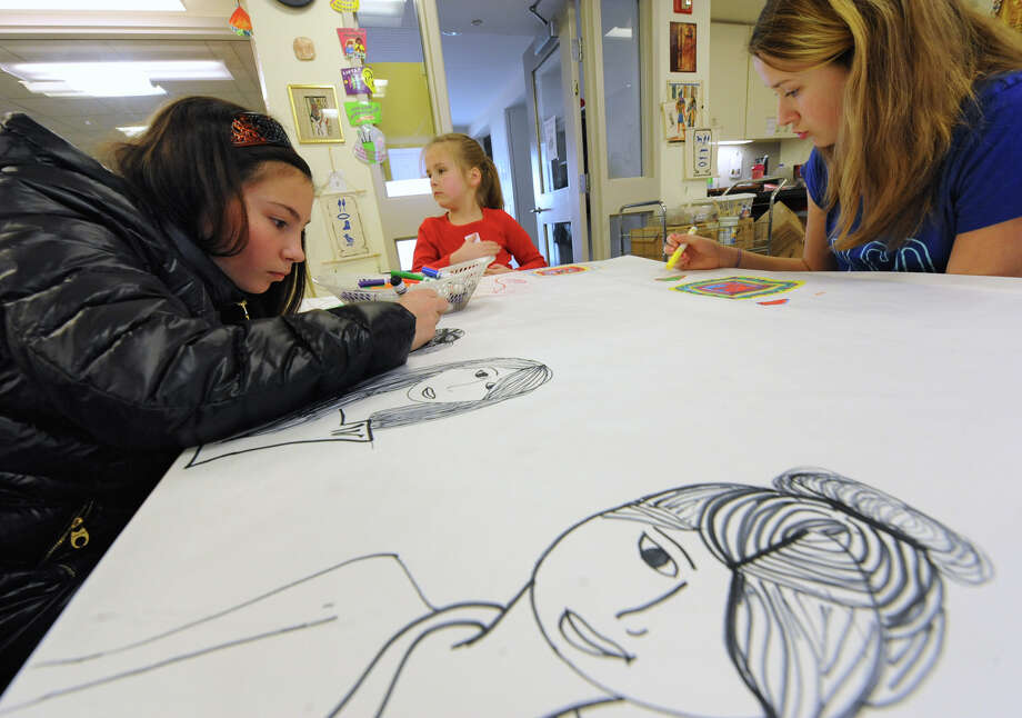 From left, Whitney Wilson, 13, of Averill Park , Lilliana Jourdin, 6, of Guilderland and Gabriella Jourdin, 12, of Guilderland practice drawing before making t-shirts with Egyptian symbols or designs on them in the studio of the Albany Institute of History and Art on Friday, Jan. 3, 2014 in Albany, N.Y.  (Lori Van Buren / Times Union) Photo: Lori Van Buren / 00025239A