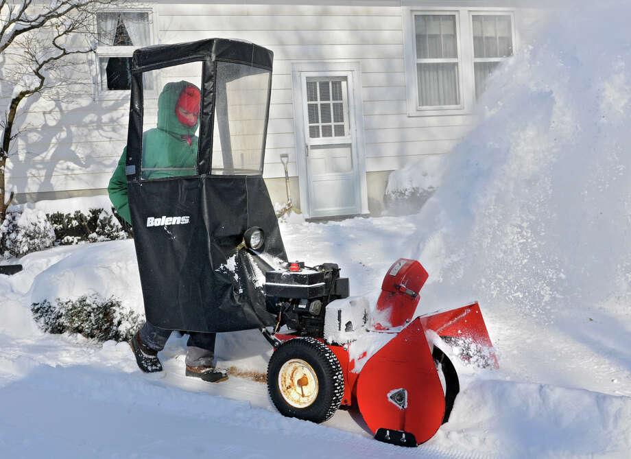 Frank Mosher uses a snowblower on his driveway on the side of his house on Friday, Jan. 3, 2014 in Delmar, N.Y. (Lori Van Buren / Times Union) Photo: Lori Van Buren / 00025215A